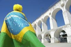 Brazil Flag Man Lapa Arches Rio Brazil. Brazilian man wearing Brazil flag and yellow wig at Arcos da Lapa Arches Rio de Janeiro Brazil Royalty Free Stock Photos