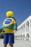 Brazil Flag Man Lapa Arches Rio Brazil. Brazilian man wearing Brazil flag and yellow wig at Arcos da Lapa Arches Rio de Janeiro Brazil Stock Photography