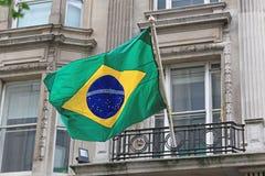 Brazil Flag. National Brazil Flag at Building Window stock images