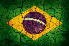 Brazil flag. Painted on cracked earth background royalty free stock photo