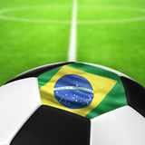 Brazil Flag Pattern of a soccer ball in green grass. Royalty Free Stock Photography