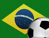Brazil Flag with Soccer Ball. Brazilian Flag with a Soccer Ball in the Foreground Stock Photography