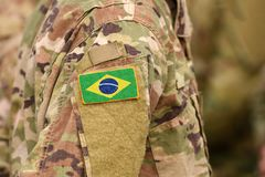 Brazil flag on soldiers arm. Brazil troops collage.  stock image