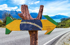 Brazil Flag wooden sign with a road background Royalty Free Stock Photos