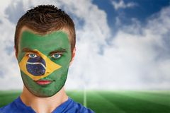 Brazil football fan in face paint Royalty Free Stock Image