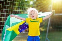 Brazil football fan kids. Children play soccer. Stock Images