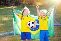 Brazil football fan kids. Children play soccer royalty free stock photography