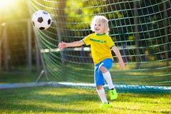 Brazil football fan kids. Children play soccer. Royalty Free Stock Photos