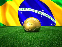 Brazil football. Golden soccer ball and brazil flag background Stock Image
