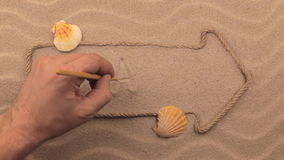 Brazil inscription written by hand on the sand, in the pointer made from rope. stock footage