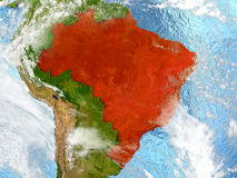 Brazil on map with clouds. Brazil in red on map with detailed landmass texture, realistic watery oceans and clouds above the surface. 3D illustration. Elements Royalty Free Stock Photography