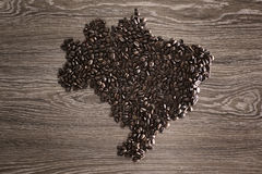 Brazil map with coffee beans. With wooden background royalty free stock image
