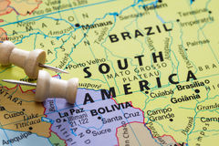 Brazil on a map. Push pin on  a world map marking Brazil as a destination concept Stock Image