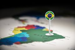 Brazil marked with a flag on the map.  royalty free stock image