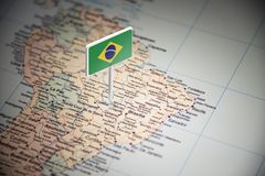 Brazil marked with a flag on the map.  royalty free stock photos