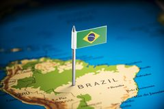 Brazil marked with a flag on the map.  royalty free stock images