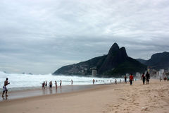Brazil Mountains and Beaches. Enjoy the beaches and mountains of Brazil with people having fun and grey sky Royalty Free Stock Photography