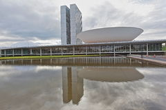 Brazil National Congress with flag in the background in Brasilia stock photography