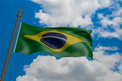 Brazil national flag blowing in the wind. 3d rendering, flag waving in the blue sky stock photo
