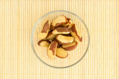 Brazil Nuts and bamboo mat Royalty Free Stock Images