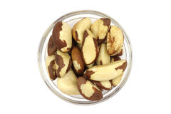 Brazil nuts in a glass bowl Royalty Free Stock Photos
