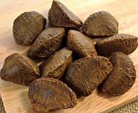 Brazil nuts on wood board Royalty Free Stock Image