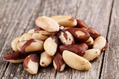 Brazil nuts on a wooden background. Some brazil nuts on a wooden background Royalty Free Stock Photography
