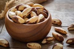 Brazil nuts in wooden bowl stock photo