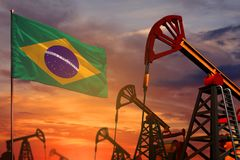 Brazil oil industry concept. Industrial illustration - Brazil flag and oil wells with the red and blue sunset or sunrise sky backg. Brazil oil industry concept vector illustration