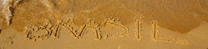 Brazil on the sand, water, sand and letters. Brazil on the sand, washed by the water, clean of the Atlantic ocean Stock Photo