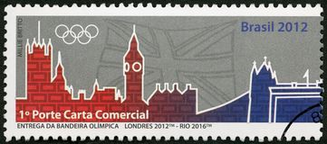 BRAZIL - 2012: shows Olympic Rings, London 2012- Rio 2016, 31th Olympic Games, Rio, Brazil. BRAZIL - CIRCA 2012: A stamp printed in Brazil shows Olympic Rings Royalty Free Stock Images