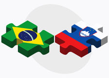Brazil and Slovenia Flags in puzzle isolated on white background Royalty Free Stock Images