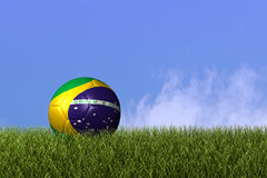 Brazil Soccer Ball. Image of a soccer ball with the flag from Brazil on grass Royalty Free Stock Photos