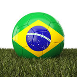 Brazil soccer ball. On grass Royalty Free Stock Photography