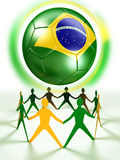 Brazil soccer ball and human chain in green and yellow Stock Photos