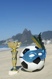 Brazil Soccer Champion Trophy Football with Carnival Mask Rio Beach Royalty Free Stock Photos