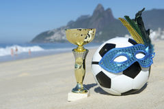 Brazil Soccer Champion Trophy Football with Carnival Mask Rio Beach Stock Image