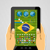 Brazil soccer championship app tablet infographic. Brazil soccer championship tablet pc infographic with world map and icons elements. EPS10 vector organized in Royalty Free Stock Images