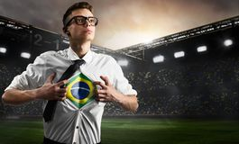 Brazil soccer or football supporter showing flag. Under his business shirt on stadium royalty free stock photos