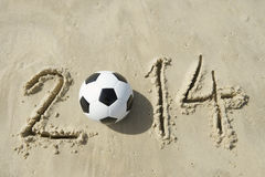 Brazil 2014 Soccer Football World Cup Message on Sand. Brazil 2014 World Cup message with football soccer ball on beach in Rio Stock Images