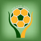 Brazil soccer in hand Royalty Free Stock Photography
