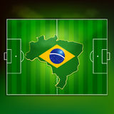 Brazil soccer pitch. Brazil flag on soccer pitch top view background Royalty Free Stock Photo