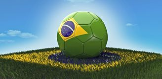 Brazil 2014 Soccer World Cup. Brazil soccer ball on the soccer field with the Brazilian flag texture Stock Image