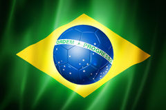Brazil soccer world cup 2014 flag. Brazil world cup 2014 symbol, soccer ball on brazilian flag Royalty Free Stock Image