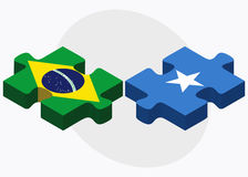 Brazil and Somalia Flags in puzzle isolated on white background Royalty Free Stock Photo