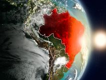 Brazil during sunrise. Highlighted in red on planet Earth with visible country borders. 3D illustration. Elements of this image furnished by NASA Royalty Free Stock Image