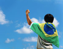 Brazil supporter hand up. And facing the sky Royalty Free Stock Photos