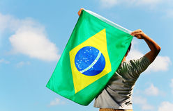 Brazil supporter holding flag Stock Photos