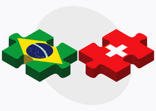 Brazil and Switzerland Flags in puzzle isolated on white background Royalty Free Stock Images