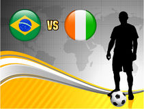 Brazil versus Ivory Coast on Abstract World Map Background Stock Photos